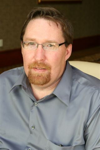 Scott Burlingame white male wearing glasses with facial hair and a blue shirt