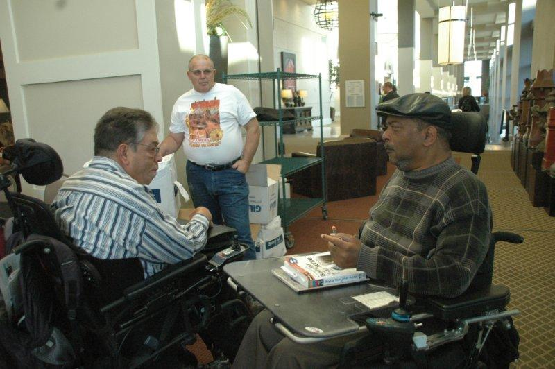 Two men in chairs having a discussion